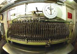This old machine determines the surface area of a hide in square feet.