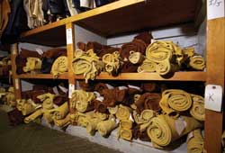 Tanned and dyed hides are waiting to be made into products for clients.